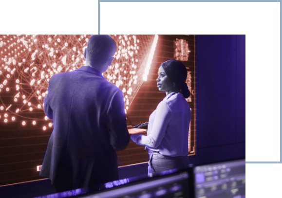 concept photo: man and woman in control room looking at screen with data